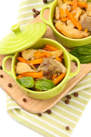 Homemade beef stir fry with vegetables in color pans, isolated on white photo