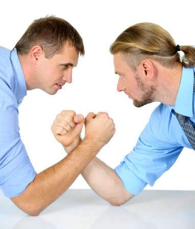 Arm wrestling of business people isolated on white photo