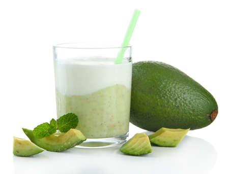 Fresh avocado smoothie isolated on white photo