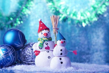 Beautiful snowmen and Christmas decor, on bright background Stock Photo