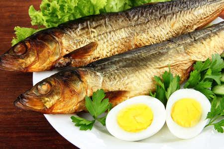 Smoked fish on plate close up photo