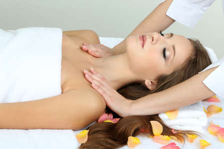 Beautiful young woman during massage in cosmetic salon close up Stock Photo - 24173551