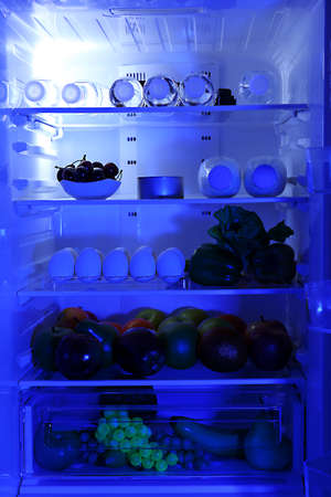 Refrigerator full of food photo