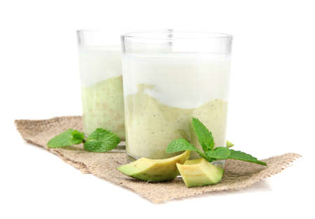 Fresh avocado smoothie isolated on white Stock Photo - 23405606