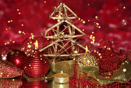Christmas composition  with candles and decorations in red and gold colors on bright background photo