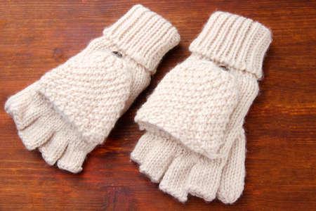 fingerless gloves: Wool fingerless gloves, on wooden background Stock Photo