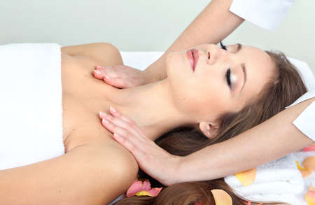 Beautiful young woman during massage in cosmetic salon close up Stock Photo - 24174271
