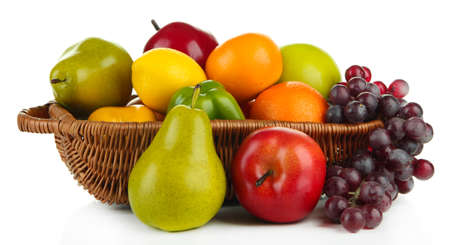 Different fruits and vegetables in basket isolated on white photo