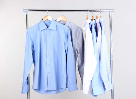 Office Male Clothes On Hangers, On Gray Background Stock Photo   23537390