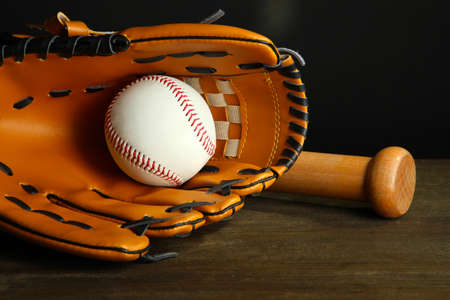 Baseball glove, bat and ball on dark background Stock Photo - 23710455