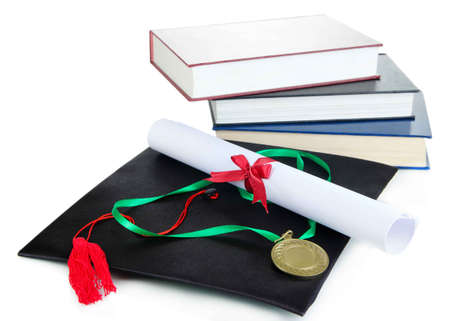 Medal for achievement in education with diploma, hat and books isolated on white photo