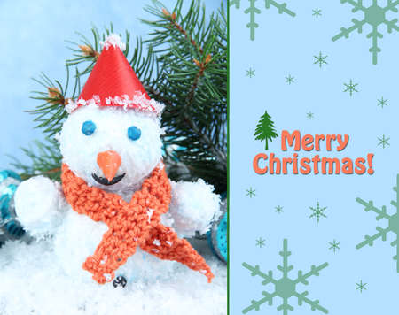Beautiful snowman and Christmas decor, on blue background photo