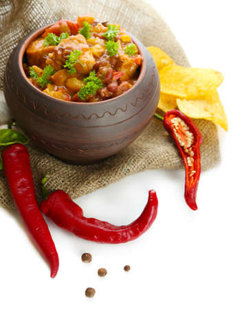 Chili Corn Carne - traditional mexican food, in pot, on sackcloth, isolated on white Stock Photo - 23713777