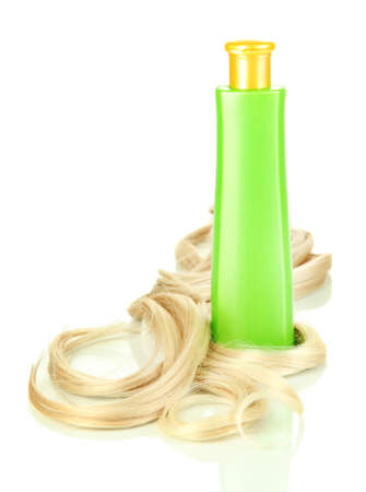Curly blond hair with shampoo close-up isolated on white photo