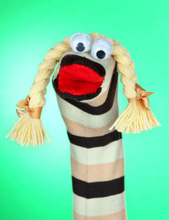 sock puppet: Cute sock puppet on green background