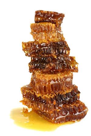 sweet honeycombs with honey, isolated on white photo