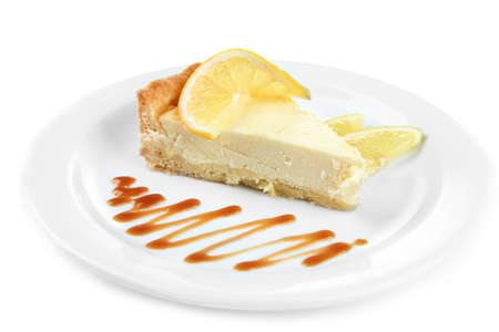 cheese cake: Slice of  lemon cheesecake  and sauce  on plate, isolated on white Stock Photo