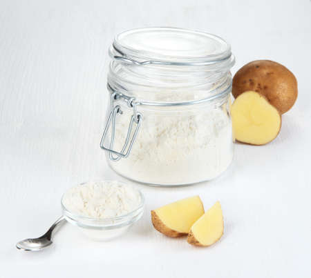 starch: Starch in bowl and bank on wooden table close-up