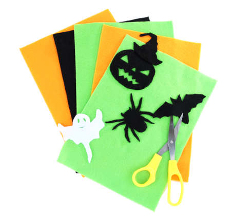 Bright felt and handmade Halloween decorations, isolated on white photo