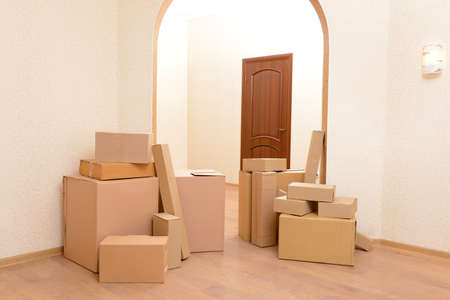 unfurnished: Empty room with stack of cartons: moving house concept