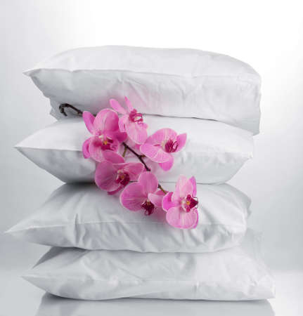 pillows and flower, on grey background photo