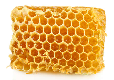 Sweet honeycomb isolated on white photo