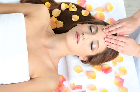Beautiful young woman during facial massage in cosmetic salon close up Stock Photo - 24173246
