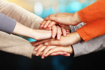 building trust: Human hands on bright background Stock Photo