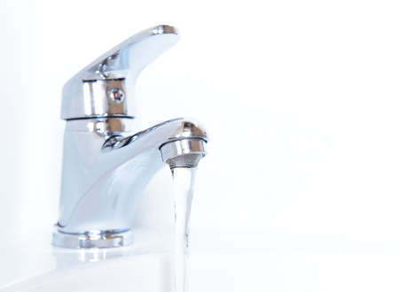 Close-up of human hands being washed under faucet in bathroom, isolated on white photo