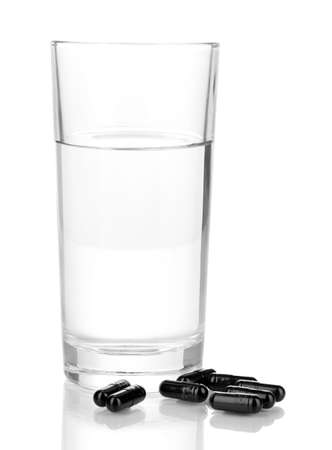 activated: glass of water and activated carbon isolated on white Stock Photo