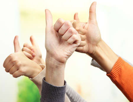 sureness: Human hands on bright background Stock Photo