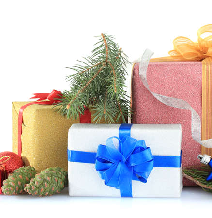 Beautiful bright gifts and christmas decor, isolated on white photo