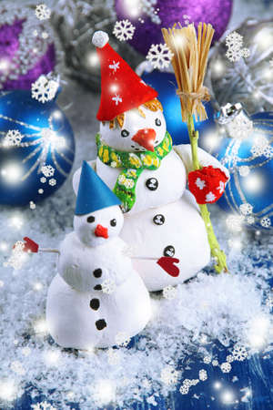 Beautiful snowmen and Christmas decor, on bright background photo