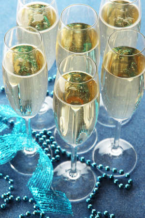 Glasses with champagne on shiny background photo
