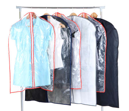 Office female clothes in cases for storing on hangers, isolated on white Stock Photo - 23886927