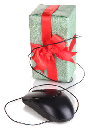 Gift and computer mouse isolated on white photo