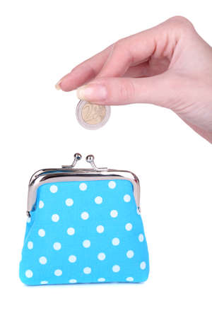 Blue purse and coin in female hand isolated on white photo