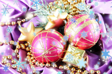 Beautiful Christmas decor on purple satin cloth photo