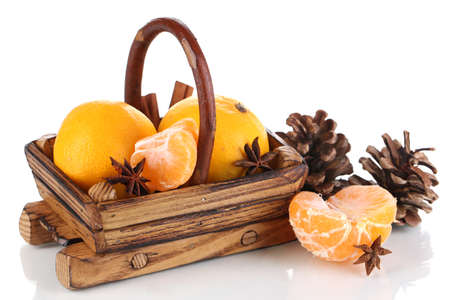 Christmas tangerines in basket isolated white photo