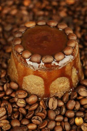 Yummy chocolate cake on coffee beans background  photo