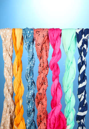 multiple personality: Colored scarves on blue background
