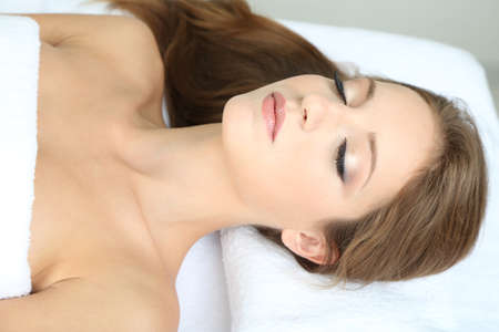 Beautiful young woman on massage table in cosmetic salon close up Stock Photo - 24175630