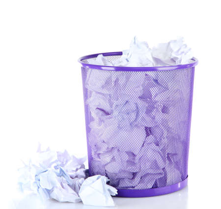 Recycle bin filled with crumpled papers, isolated on white photo