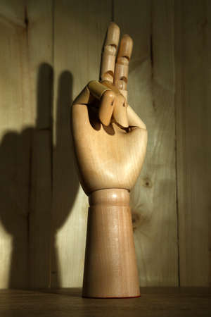 breadth: Wooden hand on wooden background Stock Photo