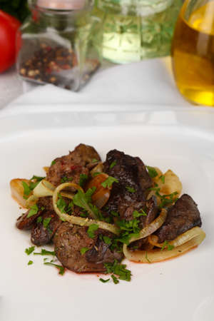 appetizing: Appetizing fried chicken livers on plate close-up