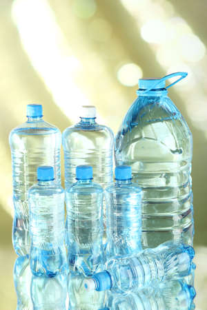 Water in different bottles on light background Stock Photo - 24033462