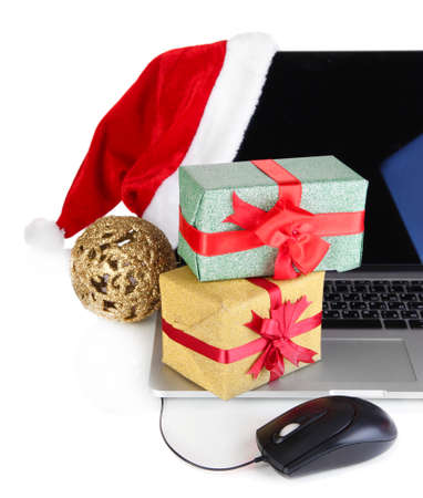 Laptop, gift and computer mouse isolated on white photo
