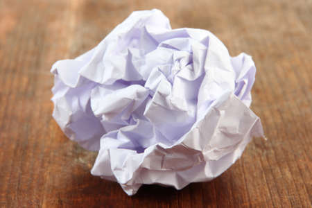 wastrel: Crumpled paper ball on wooden background Stock Photo