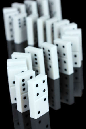 Dominoes isolated on black photo