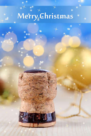 popping the cork: Champagne cork on Christmas lights background